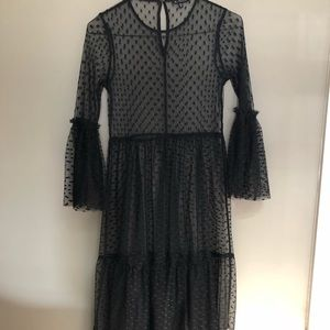 Sheer long sleeved overlay dress